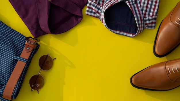 Men fashion clothing set isolated on a yellow background. business clothes concept