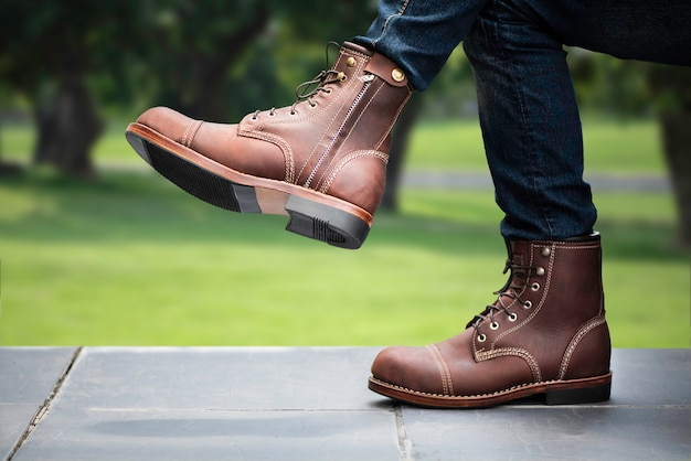 Men fashion concept. brown boots leather with zipper.