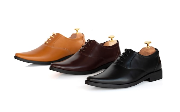 Men fashion leather collection oxford shoes with shoe tree (shape supporter) isolate on white.