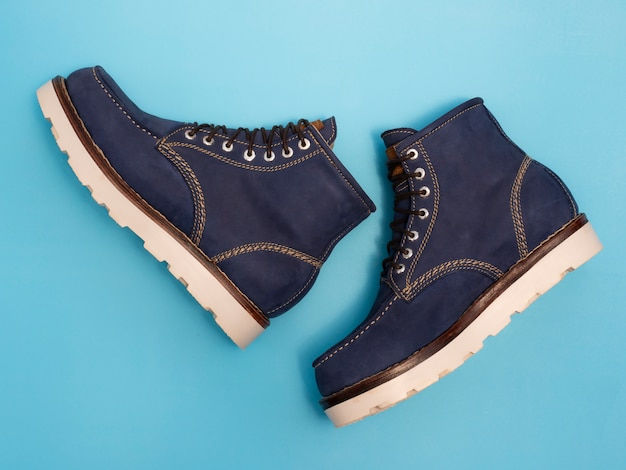 Men fashion navy boots with nubuck leather isolated