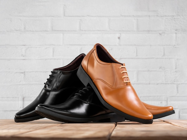 Men fashion office shoes on white brick background.