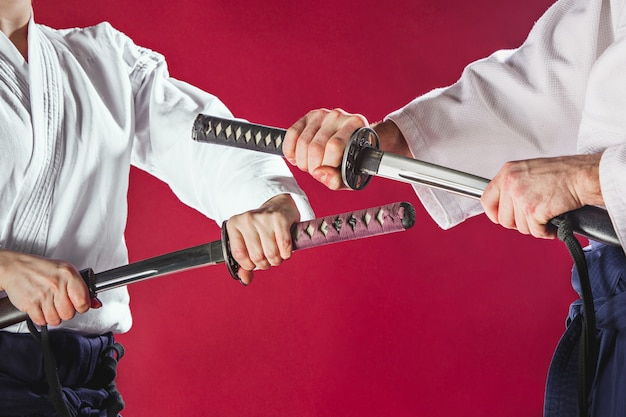 Men fighting at aikido training in martial arts school healthy lifestyle and sports concept