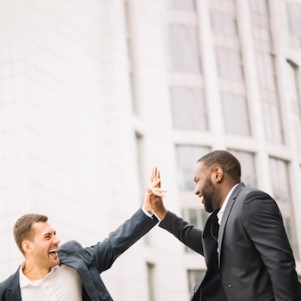 Men giving high five