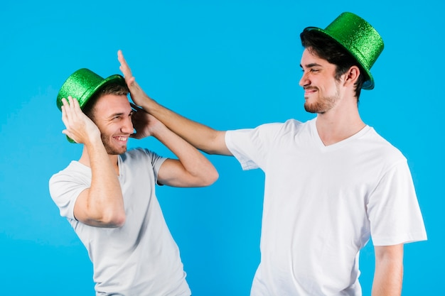 Men in green splendid hats having fun