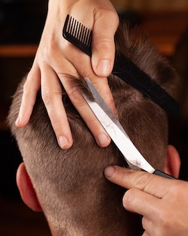 Men haircut. hair cutting with scissors