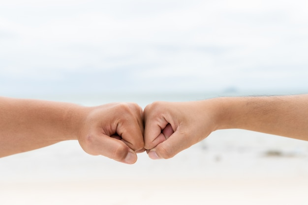 Men hands fist bumping together. friendship day concept. Premium Photo