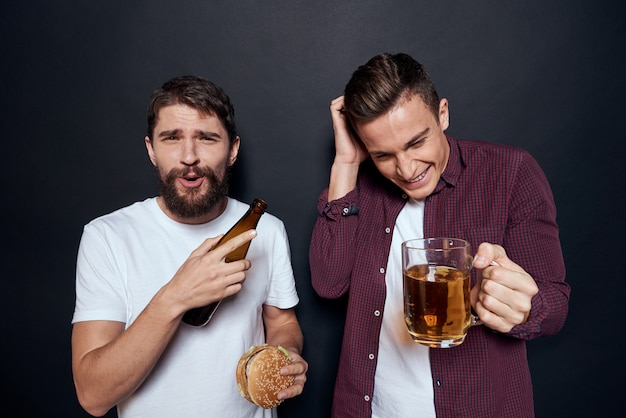 Men have fun drinking beer and eating fast food