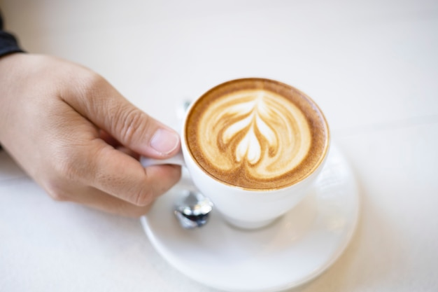 Men holding hot cup of coffee