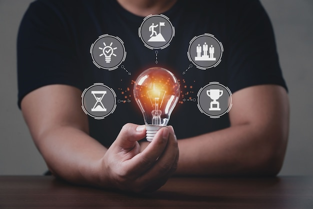 Men holding light bulbs, banner hackathon design sprint-like event. hackathon programming team work brainstorm software forum concept.