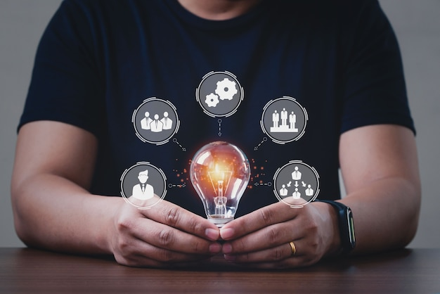 Men holding light bulbs, connection technologies for business. company organization branches template.