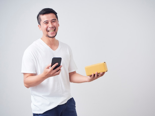 Men holds box parcel from online shopping