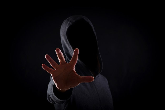 Men in hoodies in black background