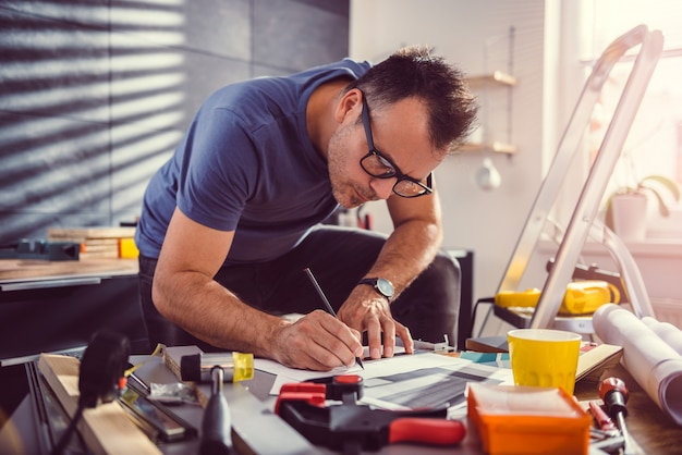 Men looking at blueprints during kitchen renovation