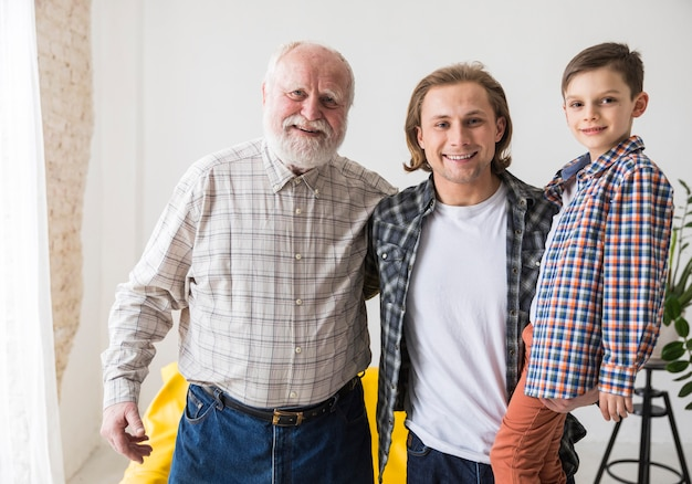 Men relatives smiling and standing looking at camera