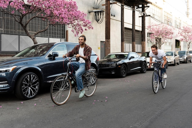 Men riding bicycles in city