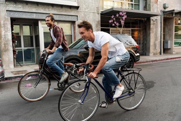 Men riding bicycles full shot