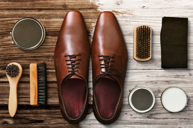 Men's leather shoes flat lay with polishing tools