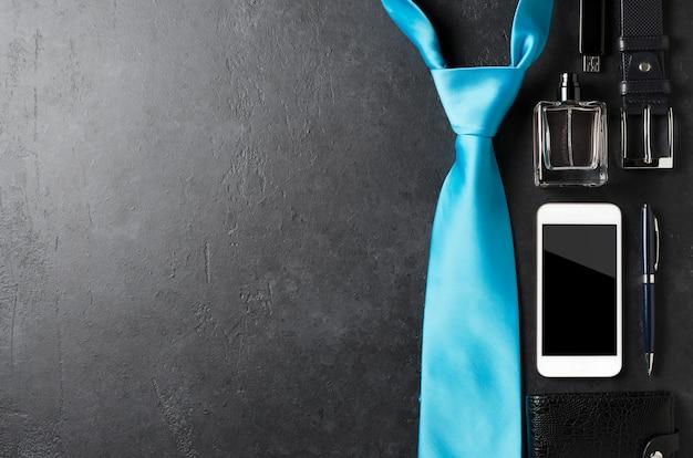 Men's accessories on a black concrete