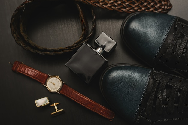 Men's accessories on the brown wooden table