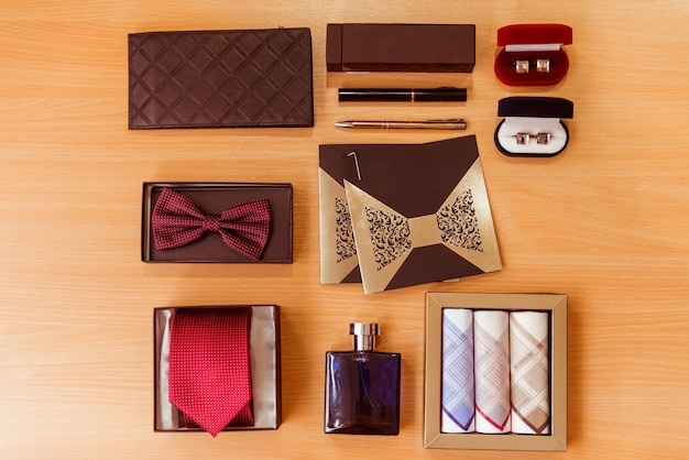 Men's accessories lying on wooden table