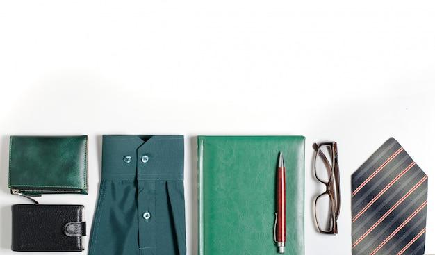 Men's accessories. tie, green notebook, glasses, purse, business