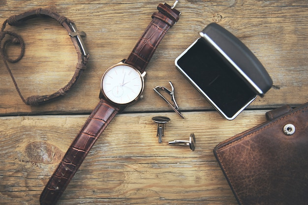 Men's accessories on wooden table