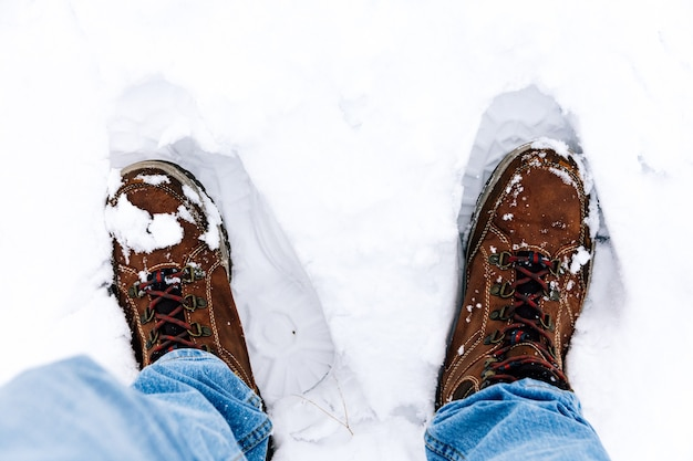Men's boots sunk in the snow