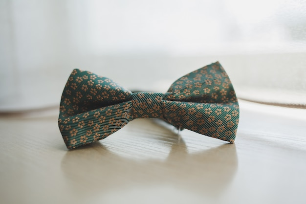 Men's bow tie on a wooden background