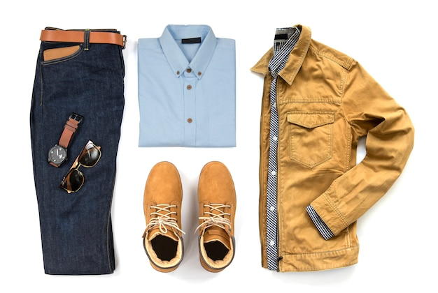 Men's casual outfits for man clothing with blue shirt, blue jeans, belt, watch, sunglasses and yellow boot isolated on white background, top view