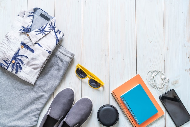 Men's casual outfits of traveler, summer holiday background