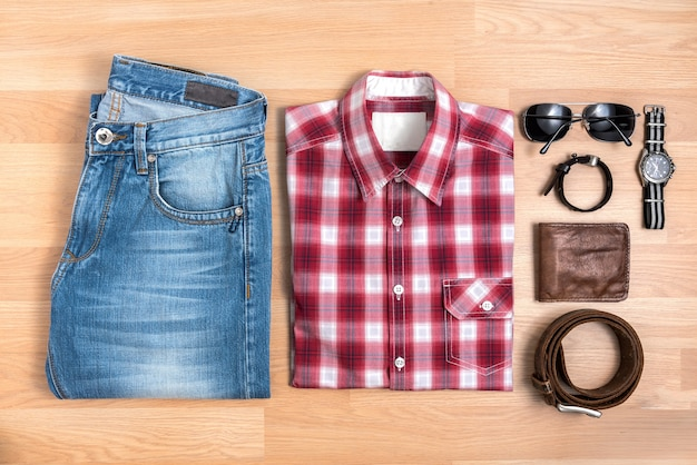 Men's casual outfits with accessories on wooden table top view