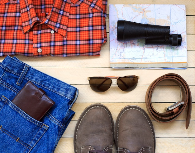 Men's casual outfits with man clothing, travel preparations and accessories