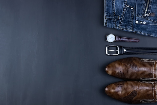 Men's casual outfits with men's clothing and accessories on a grey grunge background