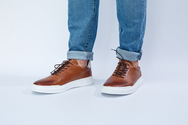 Men's casual shoes are brown with natural leather, men on the shoe in brown lace shoes. high quality photo