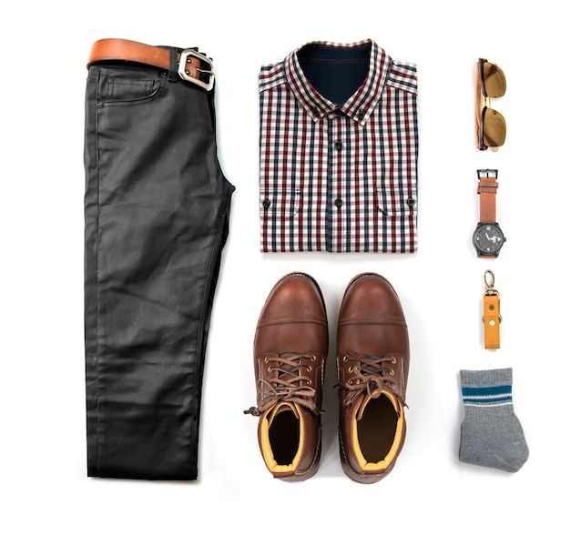 Men's clothing set with brown boots , watch, blue jeans, belt, wallet, sunglasses, black shirt and bracelet isolated on white background, top view