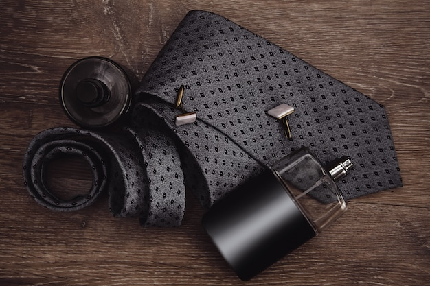 Men's everyday objects on a dark background. business meeting. accessories for the business of the day.