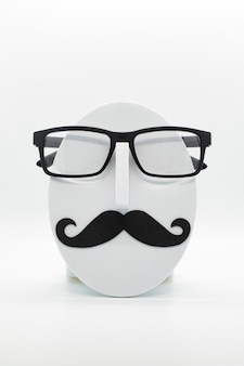 Men's fashion mannequin wearing fashionable spectacles on white background.