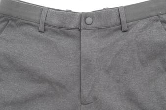 白い背景の上の男性のグレーのズボン
