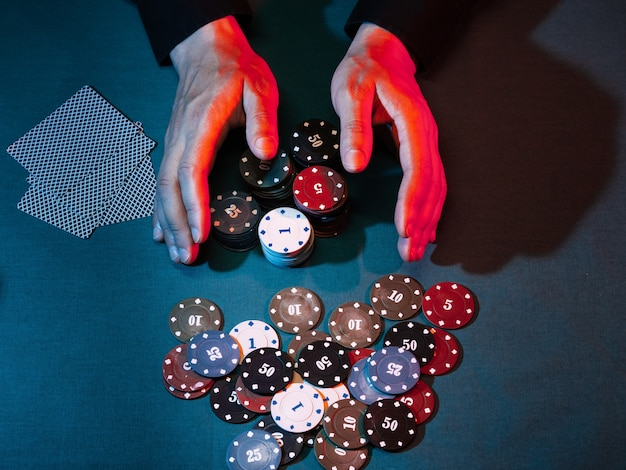 Men's hands place a bet with playing chips