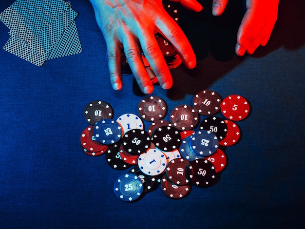 Men's hands place a bet with playing poker chips