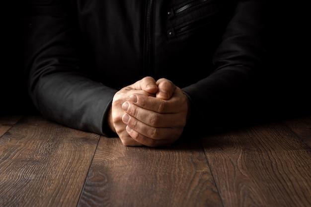 Men's hands in prayer