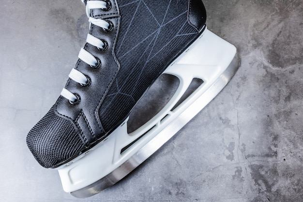 Men's hockey black and white skates on gray