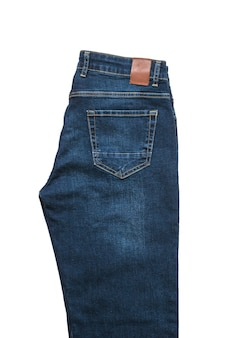 Men's jeans with a leather tag isolated on a white surface. fashionable denim men's clothing. flat lay. the view from the top.