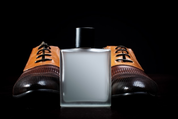 Men's leather shoes and perfume close-up