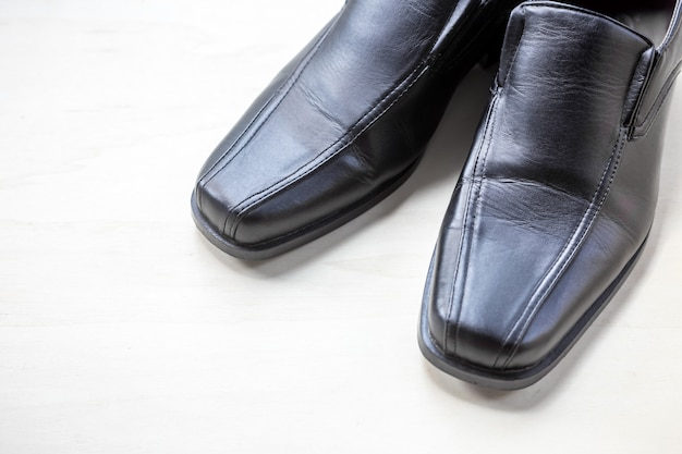 Men's leather shoes on wood