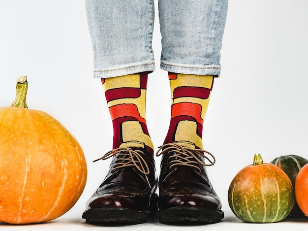 Men's legs, fashionable shoes and colorful socks