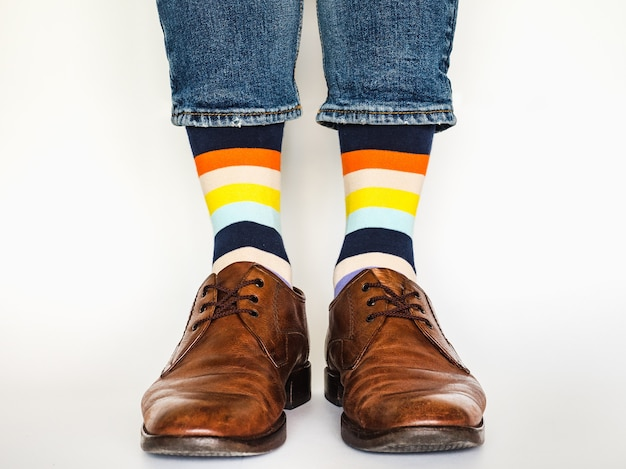 Men's legs with trendy shoes and bright socks