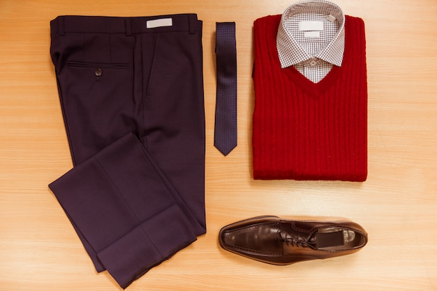 Men's shirt, sweater, trousers, tie and shoes.