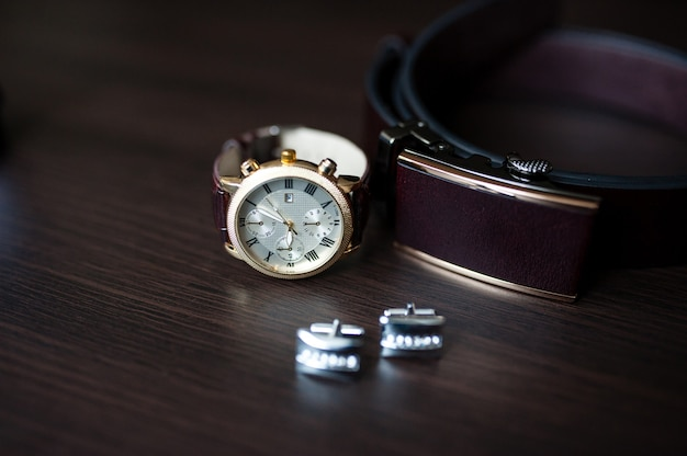 Мужские часы и запонки