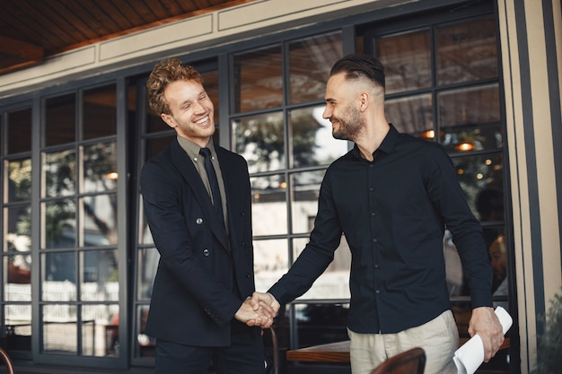 Men shake hands. enclosure of a business agreement. understanding between business partners.
